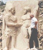 Hercules shakes hand of the king